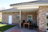 Massivhaus bungalow mit garage  Massivhaus Bungalow bauen, Winkelbungalow bauen, ebenerdig planen ...